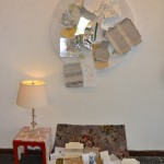 Offering plate, repurposed table, tablecloth, discarded packaging, carpet, small table, lamp, 140 x 90cm
