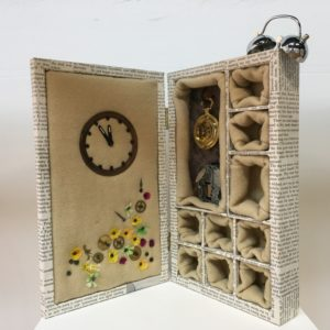 Sleeping through the glut, 2017, 33x20x6, repurposed wooden box, old textiles, decoupage, wind up music box, old clock parts, wool, faux flowers