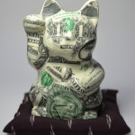 D. Kitty 2014 bank notes on ceramic, silk, polyester filling 13 x 12 x 12 cm