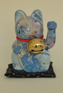 Trillion dollar cat 2014 Paper on plastic, cord, metal bell 20x 15x 11.5cm